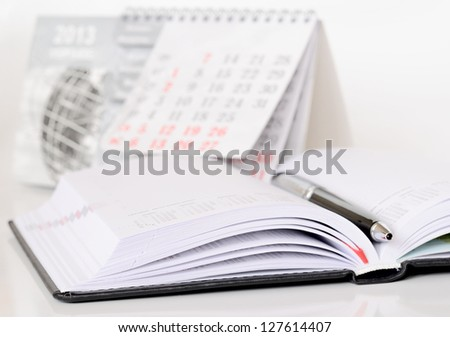 Pen on an opened diary - stock photo
