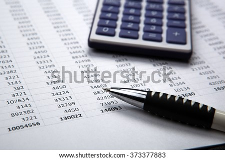pen on background of calculator and accounting papers - stock photo