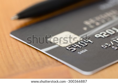 Pen on black credit card - stock photo