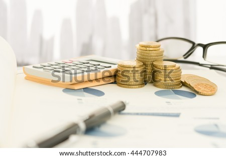 Pen on financial report with calculator, money on table of investor.  - stock photo