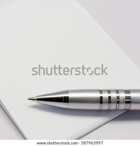 pen on paper blank book - stock photo