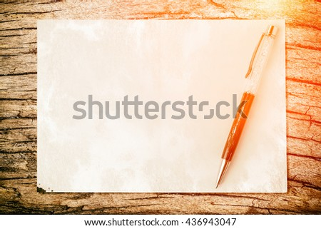 Pen on paper texture background with light and flare. Business concept. - stock photo