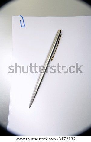 Pen on paperwork - stock photo