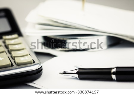 Pen on receipt with part of paper nail and calculator - stock photo