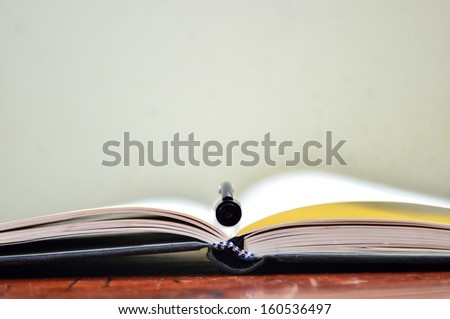 Pen on the book. Selective focus, soft focus and shallow depth of fields (DOF) - stock photo