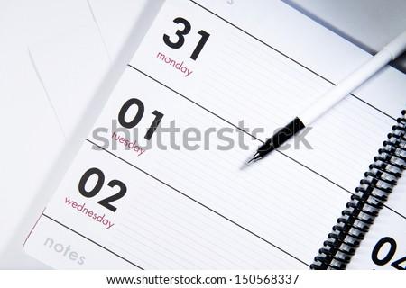 Pen on the calendar - stock photo
