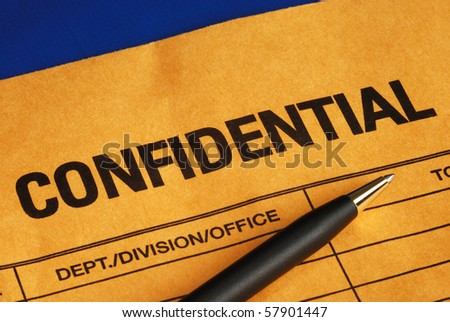 Pen on the confidential envelope isolated on blue - stock photo