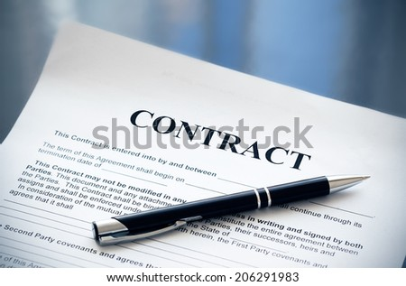 Pen on the contract papers - stock photo