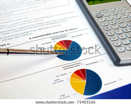 Pen on the investment chart with calculator - stock photo