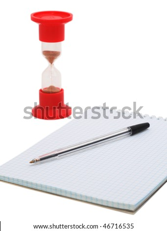 pen on the notebook and the sand-glass - stock photo