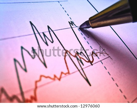 Pen showing diagram on financial report 5 - stock photo