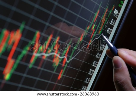 pen showing financial chart on screen - stock photo