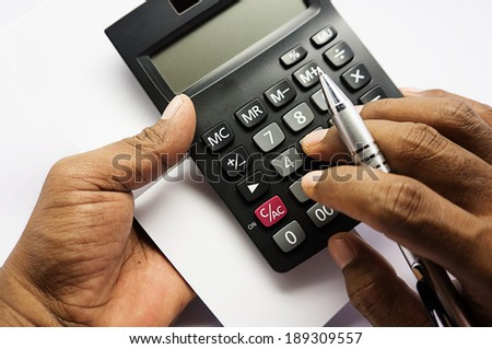 pen with books and calculators - stock photo
