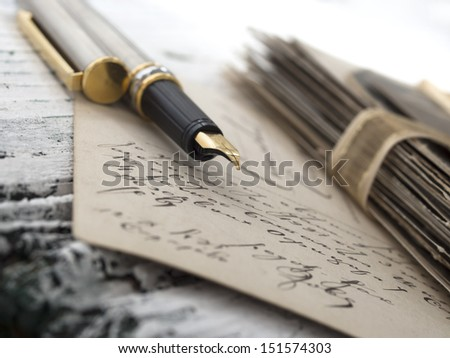 pen with old letter, vintage memories - stock photo