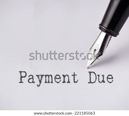 Pen writes payment due on paper  - stock photo