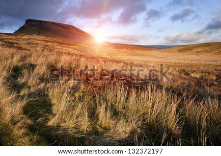 Pen-y-Ghent Yorkshire Dales National Park Autumn sunset evening - stock photo
