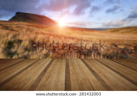 Pen-y-Ghent Yorkshire Dales National Park Autumn sunset evening with wooden planks floor - stock photo