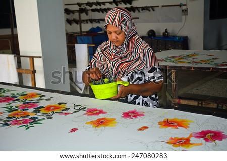 PENANG - JANUARY 6: Batik workshop at January 6, 2015 in Penang, Malaysia. Batik is a popular souvenir from Penang. - stock photo