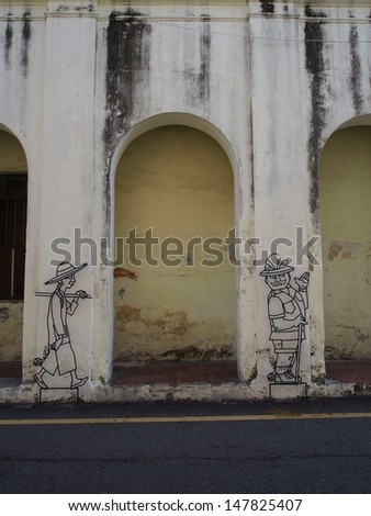PENANG, MALAYSIA-APRIL 17: Penang wire art and mural at Victoria street on April 17, 2013. The wire frame arts work is around the Georgetown heritage zone.  - stock photo
