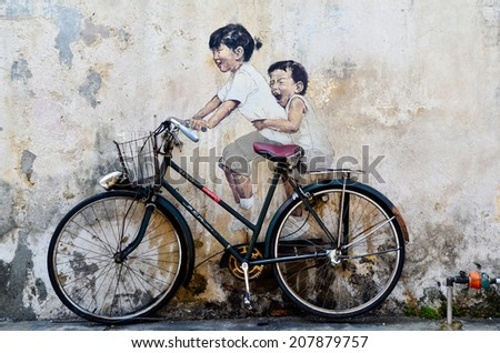 PENANG, MALAYSIA- circa JULY 2013: Street Mural tittle 'Little Children on a Bicycle' painted by Ernest Zacharevic in Penang. - stock photo