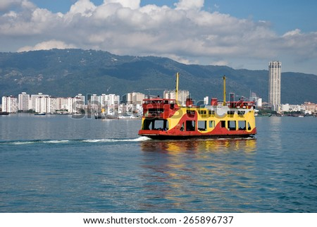 PENANG, MALAYSIA- MAC 24, 2015 : Ferry carrying passengers cruising between Malaysia mainland and Penang island. It is one of Penang tourism attractions.  - stock photo