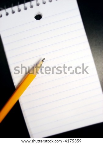 pencil and a pad of paper - stock photo