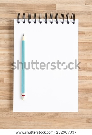 Pencil and blank notebook on wooden texture. Background for painting, drawing and sketching. - stock photo