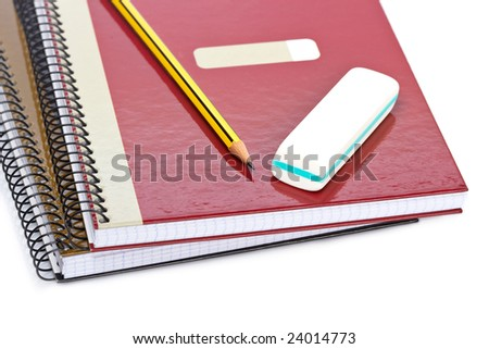 Pencil and eraser on a two notebooks with soft shadow on white background. Shallow depth of field - stock photo