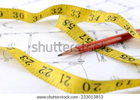 pencil and measuring tape - stock photo