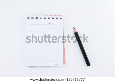 Pencil and notepad - stock photo