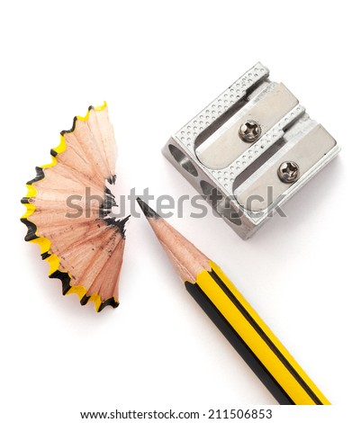 Pencil and pencil sharperner on white paper background - stock photo
