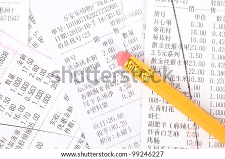 Pencil and receipt - stock photo
