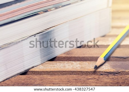 Pencil and stack of books with gradient colour filter effect,School Supplies concept. - stock photo
