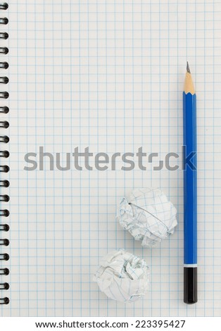 pencil at checked paper background texture - stock photo