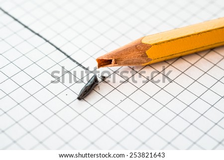 Pencil broke during drawing lines - stock photo
