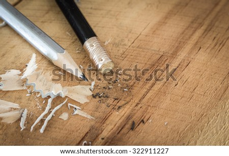 Pencil eraser on wooden table - stock photo