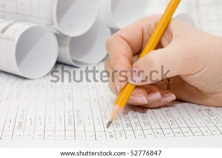 Pencil in a female hand - stock photo