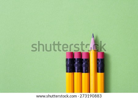 pencil isolated on green background  - stock photo