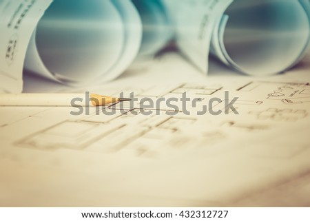 pencil on architectural for construction drawings  with roll of blueprint, vintage picture style process - stock photo