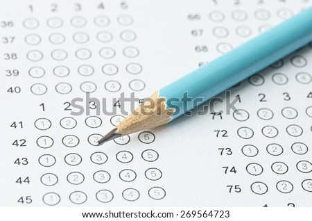 pencil on blanked answer sheet - stock photo
