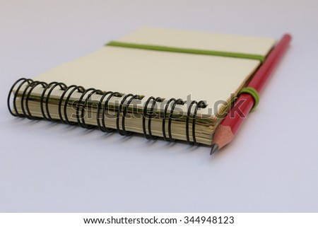 pencil on Note book  isolated on white background - stock photo