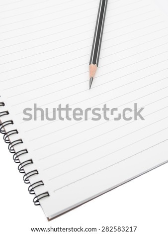 Pencil on ring binding notebook, Isolated on white background, Selective focus on pencil sharpness - stock photo