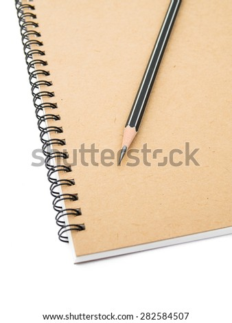 Pencil on ring binding notebook with recycle brown paper for cover page, Isolated on white background, Selective focus on pencil sharpness - stock photo