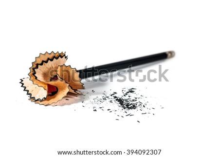 pencil on sharpener, sharpening shavings isolated on white background - stock photo