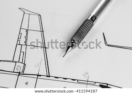 Pencil  on technical drawing of an airplane - stock photo