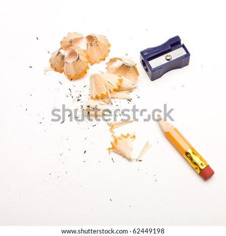 Pencil sharpener and wood shavings from low perspective isolated on white. - stock photo
