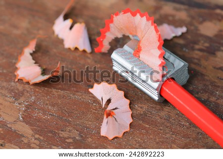 Pencil Sharpener on wooden wall - stock photo