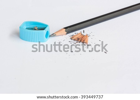 Pencil sharpener with black pencil on white background. - stock photo
