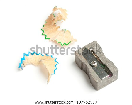 Pencil sharpener with blue and green shavings - stock photo
