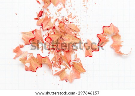 pencil shavings on white paper. close - stock photo